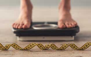Je BMI en andere factoren voor obesitas